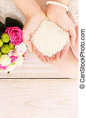 Rice in the hands of a bride