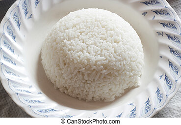 Rice in white dish on the wood table