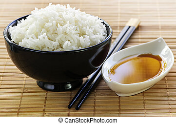 Rice meal - Rice bowl with soy sauce with chopsticks