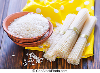 rice noodles and raw rice on a table