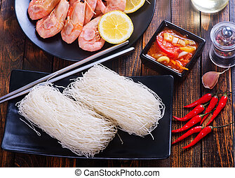 rice noodles on plate and on a table