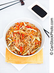 Rice noodles with vegetables in a white bowl