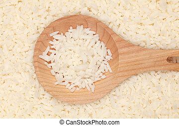 Rice on a wooden spoon