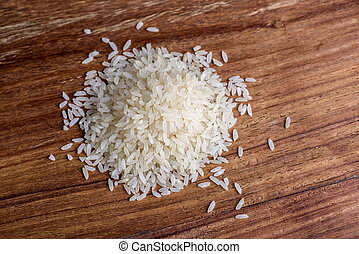 Rice on wood background