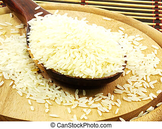 rice on wooden ladle close up