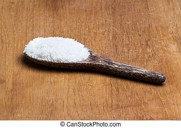 rice on wooden ladle