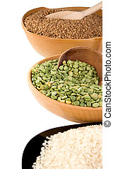 rice, pea and buckwheat in plate isolated on white