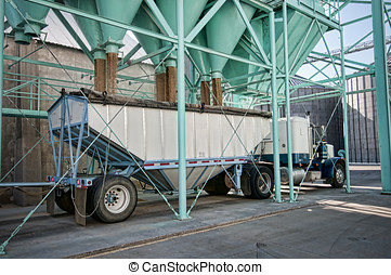 Rice processing plant - Truck picking up a load of processed...