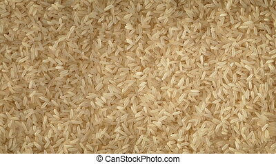 Rice Rotating Slowly - Overhead shot of rice grains turning...
