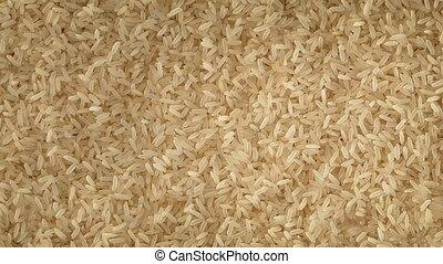Rice Rotating Slowly - Overhead shot of rice grains turning...