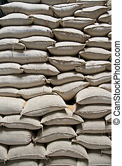 Wall of rice sacks in grain factory, Vietnam