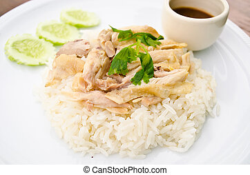 rice steamed with chicken soup at restaurant , Thailand