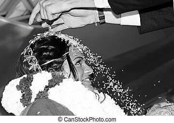 Rice Toss - Hindu Wedding - The bride and groom dump rice on...