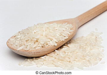 rice with a wooden spoon