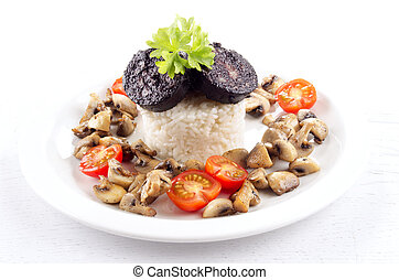 rice with black pudding on a plate