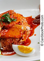 rice with chicken in red sauce