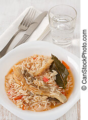 rice with fish on the white plate