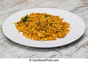 Rice with meat on a white plate