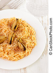 rice with mussels on white plate