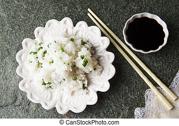 rice with onion on a white plate