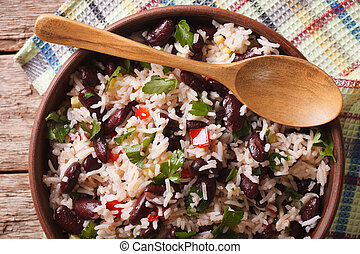 Rice with red beans in a bowl close-up on the table....