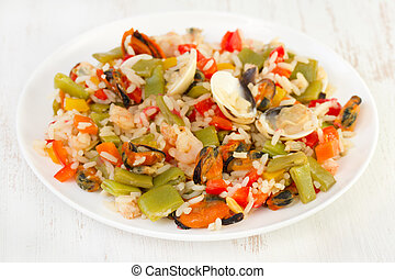 rice with seafood and vegetables on plate