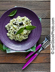 rice with slices of zucchini and olives