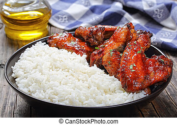 rice with tasty glazed chicken wings - rice with delicious...