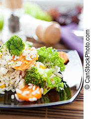 rice with vegetables on black dish