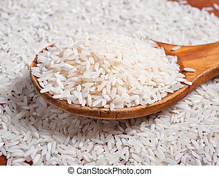 Rice with wooden spoon.