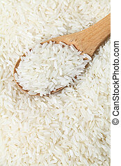 Rice with wooden spoon