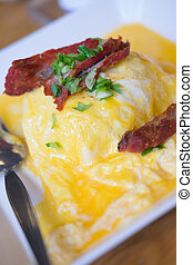 rice wrapped inside the omelette topping with roasted pork