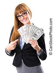 Rich business woman holding dollar bills