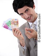 Rich businessman showing off his money