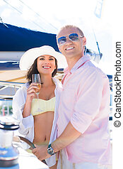 Rich couple have a party on a luxury sailing boat at summer