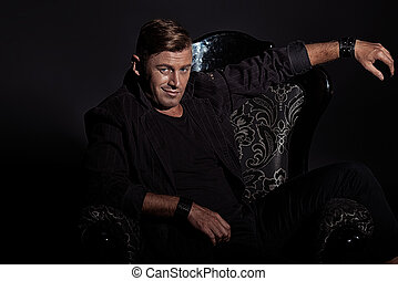 rich macho - Portrait of a confident handsome man in elegant...