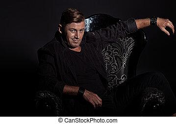 rich macho - Portrait of a confident handsome man in elegant...