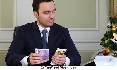 Rich man counts money