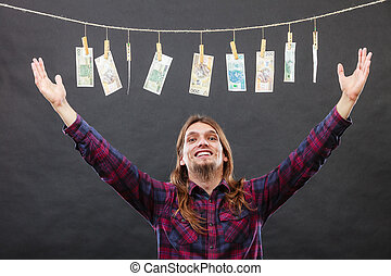 Rich man with laundry of money