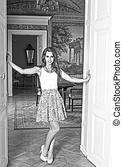 rich woman in aristocratic palace BW