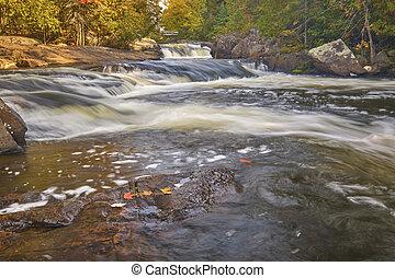Landscape photograph of Richie Falls in autumn located in Haliburton County Ontario Canada.