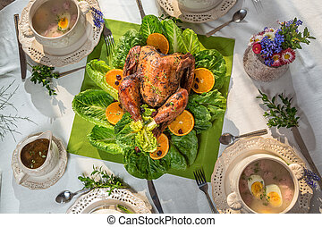 Richly set table for Thanksgiving with turkey and soup