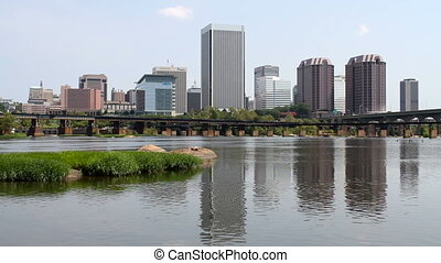 RICHMOND, VIRGINIA, USA %u2013 AUGUST 20, 2014: Skyline view of the city of Richmond, Virginia, USA, the state capital as seen from across the James River.