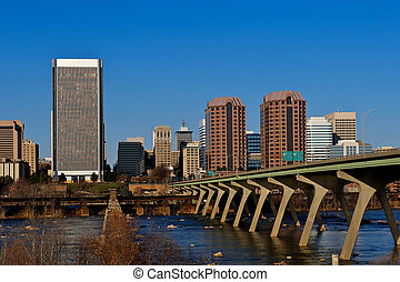 The city of Richmond, Virginia as seen from the Manchester Bridge on the James River.