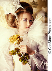 richness - Beautiful fashion model in the refined white...