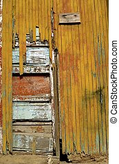 Rickety door - An old rickety wooden door displays several ...