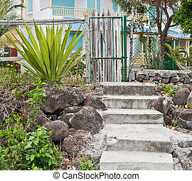 Rickety gate - Old gate and stone steps in front of a house ...