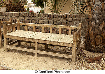Rickety old bench made of wood in the village in Africa.