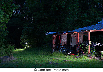Rickety shed - Old red shed near a forest with a light ...