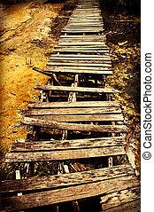 Rickety wooden bridge on the way